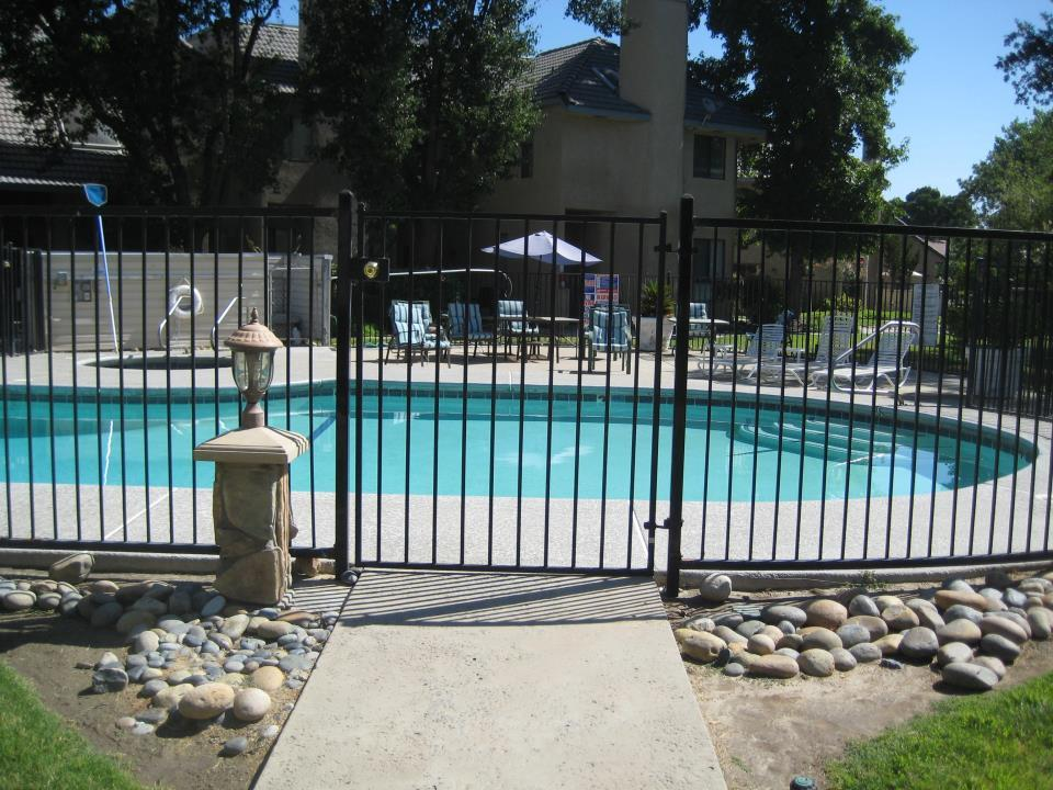 picture of a pool with a fence around it