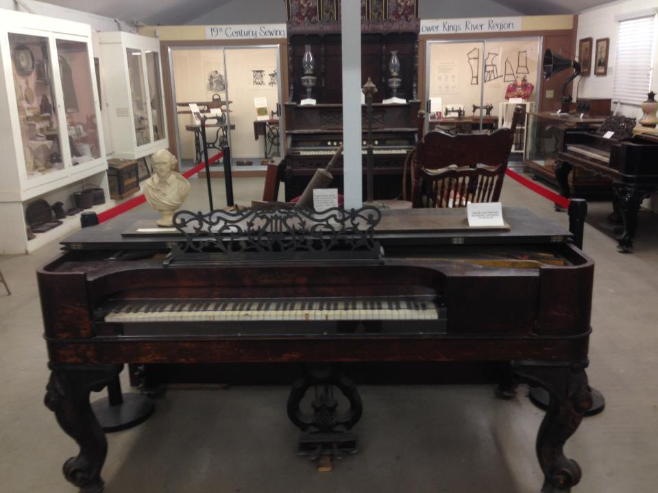 Front and center, Kranich-Bach piano with Rose- Wood case.